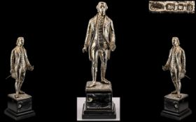 A Rare Cast Silver Figure of a Military Gentleman with one hand on a sword,