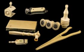 Collection of Antique Ivory to include glove stretchers, whistle, lace bobbins, card holder purse,