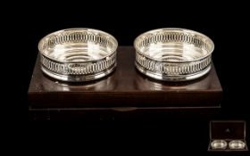 A Contemporary Pair of Fine Quality Sterling Silver Wine Coasters of Circular Form,