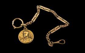 A Base Metal Albert Chain length 10 inches, suspending a World War 1 coin.