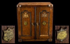 Antique Collectors Cabinet in the Form of a Safe, an oak cabinet,