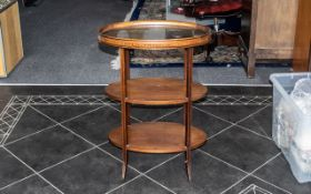A Mahogany Three Tier Edwardian What Not, oval tiers with lift of tray top,