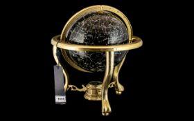 "Night Sky Gem Globe on a brass gimbel, height 14"". With original tags."