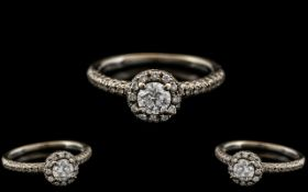 18ct White Gold - Superb and Attractive Diamond Set Dress Ring. The Central Modern Round Brilliant