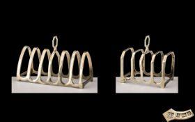 Elizabeth II Sterling Silver 6 Tier Toast rack of Small Proportions.