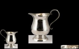 George II Style Sterling Silver Milk Jug of Small Proportions with Swan Necked Handle and Stepped