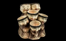 Vintage Pottery Monk Egg Holder, holds six eggs, depicts six Monks with individually painted faces.