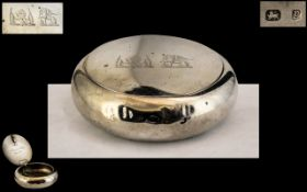 A Silver Squeeze Tobacco Box of typical oval/round form. Hallmarked for Birmingham Q 1898.