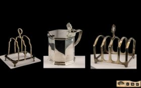 A Collection of Silver to include two toast racks,