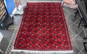 A Genuine Excellent Quality Persian Turkmen Carpet/Rug decorated in a Bukhari design on red