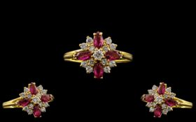 18ct Gold - Ladies Attractive Diamond and Ruby Set Ring In a Flower head Setting.