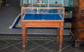 An Ex Mahogany Museum Cabinet Turned Shop Fitting with a Glazed Fold Down Front Display Top with a
