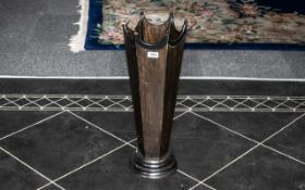 A Stained Wood Faceted Floor Standing Stick Stand missing three terminals on a circular base.