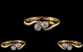 18ct Gold and Platinum - Attractive Two Stone Diamond Set Ring. Marked 18ct Gold and Platinum to