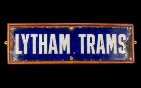 An Antique Enamel on Tin Lytham Trams Sign rough edges all around. Screwed to a modern back board.
