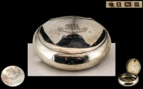 A Silver Squeeze Tobacco Box of typical oval/round form. Hallmarked for Birmingham H 1907.