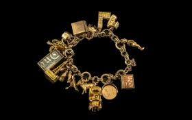 9ct Gold Vintage Charm Bracelet - Loaded with 16 9ct Gold Charms.