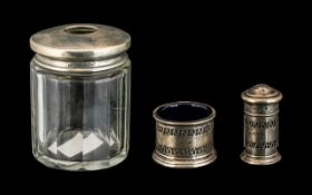 Silver Topped Glass Hair Tidy with a Silver Mustard Pot and Salt Sifter. Please See Photo.