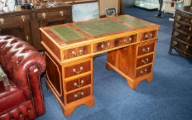 A Modern Traditional Yew Wood Pedestal Desk of typical form. Green leather top, three frieze