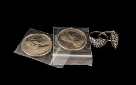 Two Canadian Silver Dollars 1969, together with a silver Marcasite ring and a silver Iolite ring.