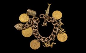 Edwardian Period - 9ct Gold Ornate Curb Bracelet Loaded with 9ct Gold Charms ( 7 ) and 22ct Gold