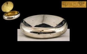 A Silver Squeeze Tobacco Box of typical oval/round form. Hallmarked for London R 1912.