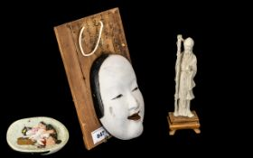 """A Small Japanese Ivory Figure 7"""" high with a Japanese erotic decorated face mask mounted on a wood"""