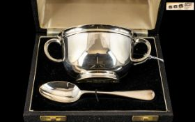 Silver Child's Feeding Bowl and Spoon. In original fitted case. Hallmarked for London 1939.