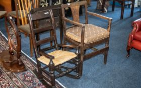A Large 18th Century Child's Correction Chair with a slatted back and a cross stretcher to the base.