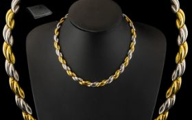 A Stunning Italian 18ct Two Tone Gold Necklace In An Attractive Design with Concealed Clasp.