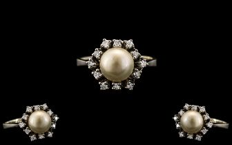 Ladies 14ct White Gold Stylish and Attractive Diamond and Pearl Set Dress Ring. The Central Pearl