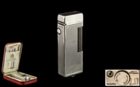 Dunhill - Swiss Made Silver Plated Roll-a-gas Lighter with Original Box and Paper. c.1960's.