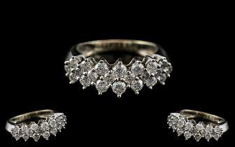 10ct White Gold - Attractive Diamond Set Dress Ring of Contemporary Design.