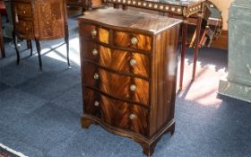 A Small Mahogany Reproduction Serpentine Fronted Chest, of pleasing proportions,