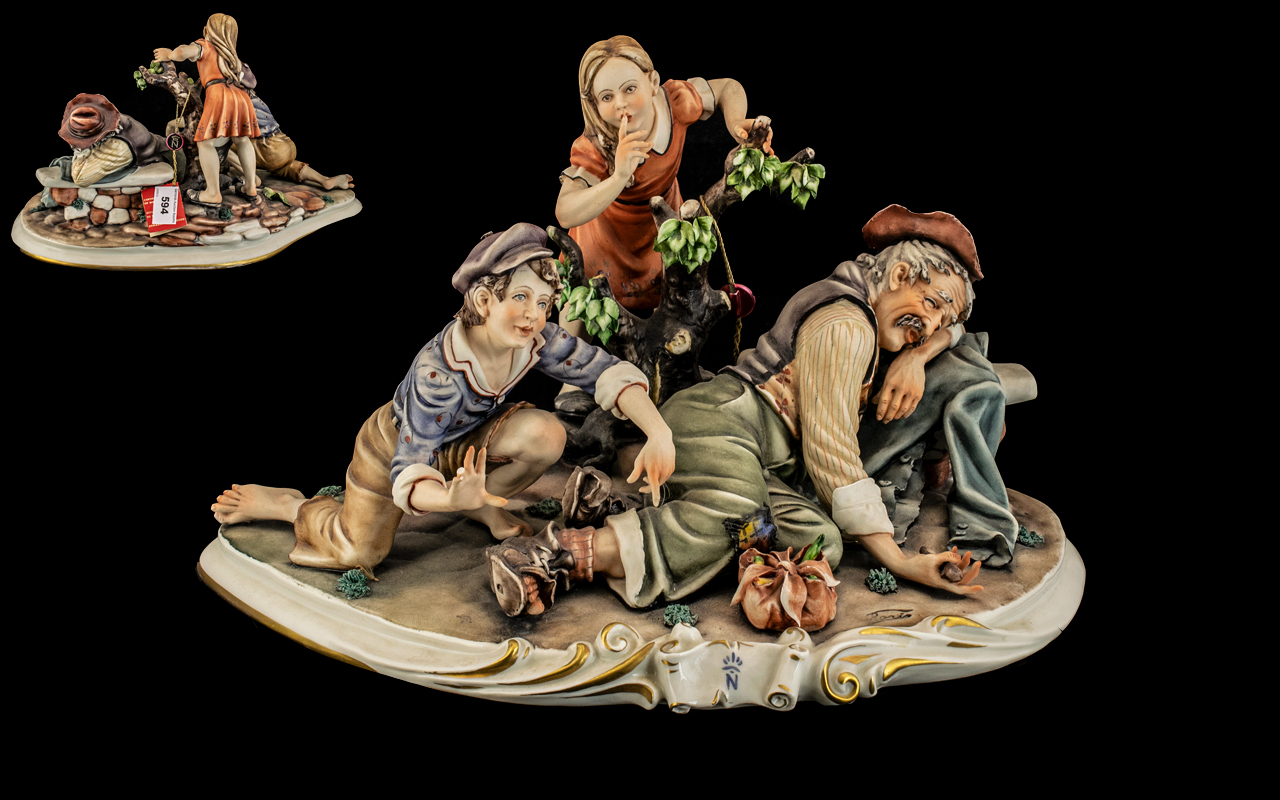 Large Capodimonte Porcelain Figure by Rori of Tramp Sleeping, with two children. 14.5'' wide.