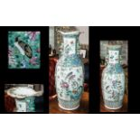 A Chinese 19th Century Cantonese Vase decorated in Famille Rose enamels,