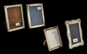 Four Photograph Frames comprising two small silver frames, 7 inches (17.5cms) x 5 inches ( 12.