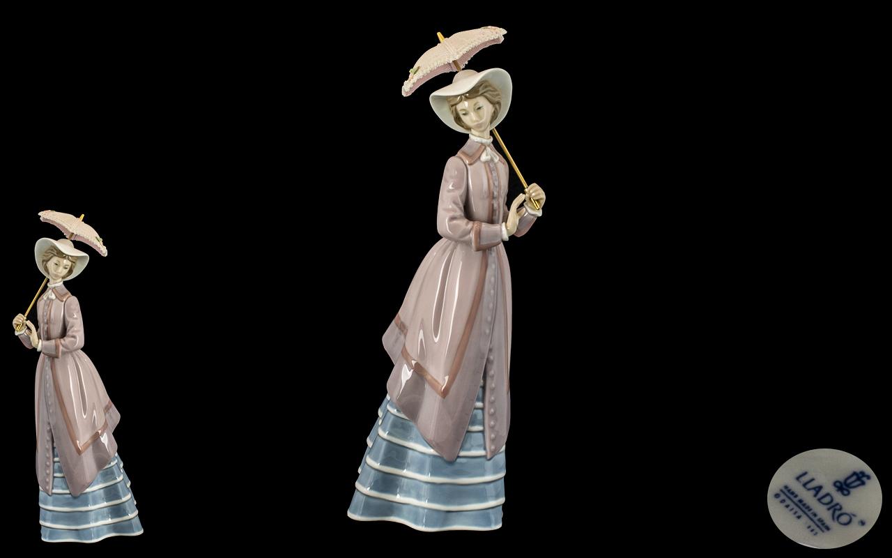 Lladro - Pleasing Hand Painted Porcelain Figure ' Parisian Lady ' with Parsol. Model No 5321.