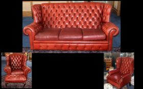 Four Piece Oxblood Button Backed Leather Chesterfield Suite, consisting of: a three seater winged