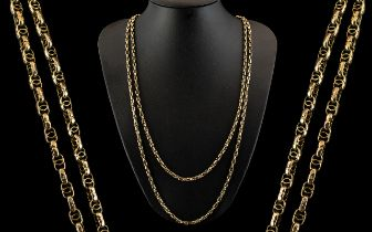 Victorian Period Attractive 9ct Gold Muff Chain with Fancy Ornate Design on Each Link. Marked 9ct.