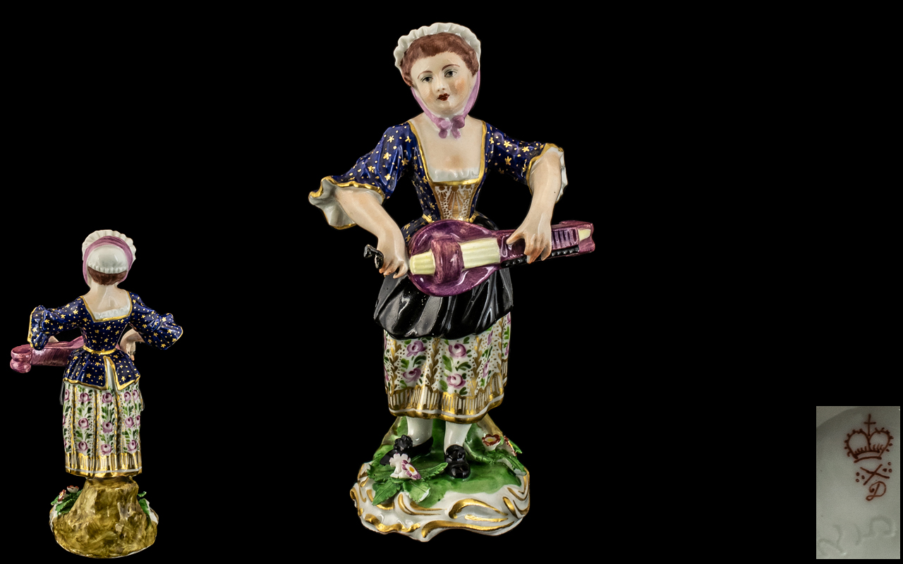 Duesbury Derby Figure of a Lady Playing a Musical Instrument, finely decorated, on an encrusted,