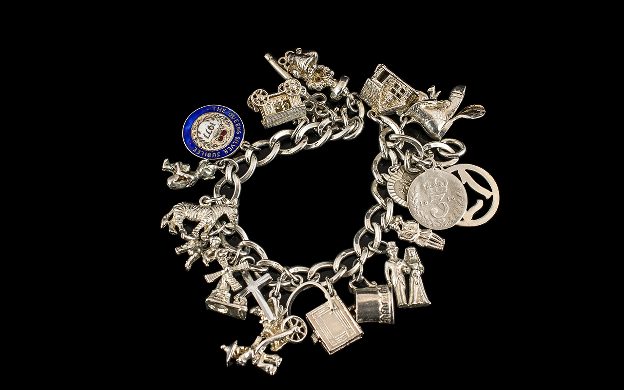 Sterling Silver - Vintage Charm Bracelet Loaded with 20 Charms.