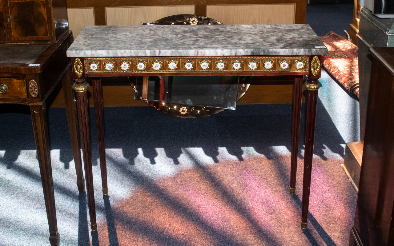 A French Marble Top Reproduction Console Table with ormolu mounted porcelain plaques applied to the