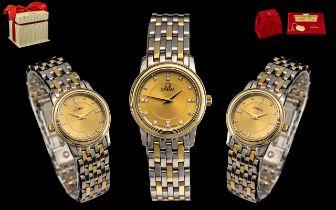 Omega - Ladies 18ct Gold and Steel Diamond Set Wrist Watch.