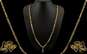 An Excellent Quality and Solid 9ct Gold Byzantine and Block Design Impressive and Heavy Long Chain.