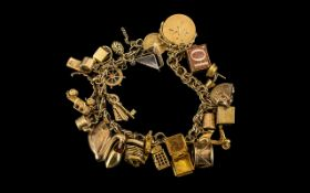 Ladies - Excellent 9ct Gold Charm Bracelet Loaded with 25 9ct Gold Charms.