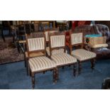 Four Edwardian Upholstered Walnut Dining Chairs, padded back and seat,