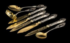Five French Silver Fruit Knives with embossed hilts and gilded blades,