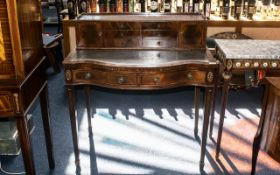 A Mid 20th Century Ladies Writing Desk, with a grey leather tooled top,