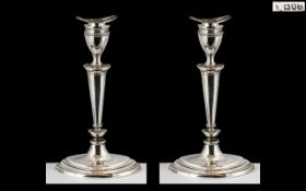 Pair of Silver Candlesticks in the Adams style, London 1906, maker TB and S; 7.5 inches (18.